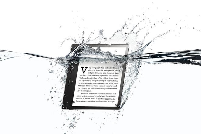 Grey Amazon Kindle Oasis in water splashes. The premium model of Amazon ebooks.