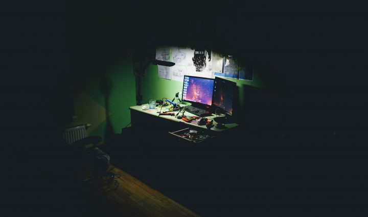 A PC in a dark room with Chrome Software Reporting Tool enabled